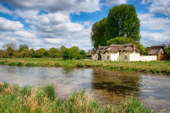 Chilbolton Cow Common in Hampshire. Thatched cottage on the banks of the river Test at Chilbolton Cow Common in Hampshire royalty free stock image