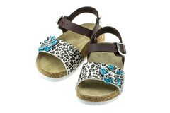Child's girls sandals with decoration of flower studded with royalty free stock image