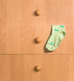 Child's sock and drawers. Child's sock hanging from a chest of drawers Royalty Free Stock Photo
