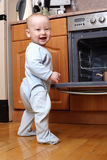 Child 1 year old in the kitchen cooking breakfast Royalty Free Stock Photography