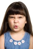 Child. Photo of a girl grimacing, isolated on white Stock Images