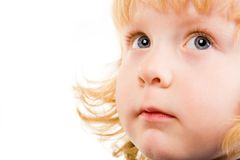 Child. Photo of adorable child with grey eyes looking aside Royalty Free Stock Images