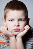 Child. The boy's face is photographed in the studio, close-up Royalty Free Stock Image
