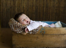Child. The small kid to a wooden box Stock Image