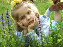 Child 18. Little pretty girl at the meadow Stock Photo