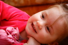 Child. The little girl fervently plays and smiles poses on the chamber Stock Images