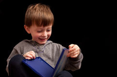 Child. Little boy playing with a plastic dvd holder Stock Photo