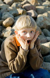 Child. Sensitive Child on a stone background Stock Images