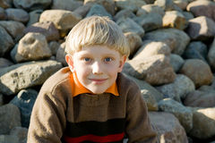 Child. Smiling Child on a stone background Royalty Free Stock Photography