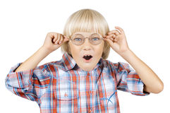 Child. Little children boy gaily astonished stare on camera above glasses , on white background, isolated stock photography