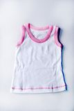 Child. Some clothes for the newly born Royalty Free Stock Images