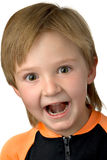 Child. Portrait of a child making a funny face while laughing loud Stock Photography