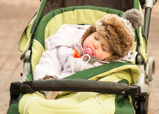 A child. Sleeps in ren's wagon Royalty Free Stock Image