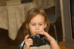 Child. With camera Stock Photography