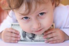 Child. On photo child with money Stock Photos