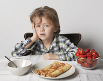 Child 6 years. Did not want to eat breakfast stock photos