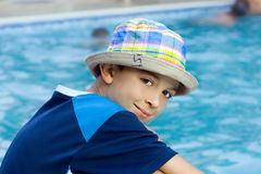 Child. Young man along swimming pool Royalty Free Stock Image