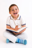 Child. Boy read between the lines Royalty Free Stock Photos