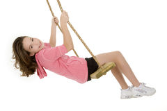 Caucasian child playing on a swing Stock Photos