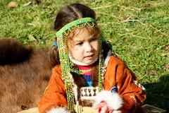 Child. Sits on skin bear Stock Photo