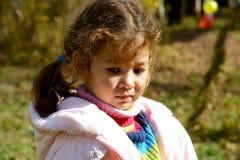 Child. Sad child on background air ball Stock Image
