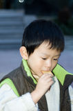 Child. Focus on the delicious snacks Royalty Free Stock Photography