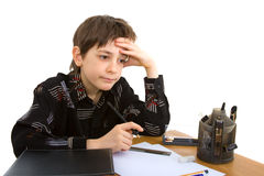 Child. With study of the difficulties on white background Royalty Free Stock Image