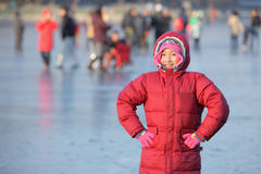 Child. Chinese little girl on the ice in winter Royalty Free Stock Photography