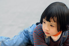 Child. A Chinese little girl staring blankly Stock Image
