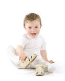 Child. With shoes sitting. Isolated on white Stock Photography