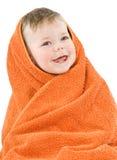 Child. In orange towel. Joyful smile. Isolated Stock Photography