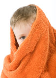 Child. In orange towel. Half face hooded Stock Photo