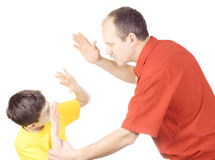 Child abuse. Young kid about to be thumped by father Stock Images