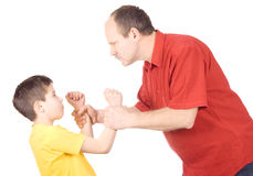 Child abuse. Young kid about to be thumped by father royalty free stock image