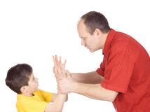 Child abuse. Young kid about to be thumped by father stock image