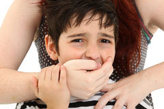 Child Abuse or Abduction. Scared 8 year old boy being abused or abducted by adult female Royalty Free Stock Photo