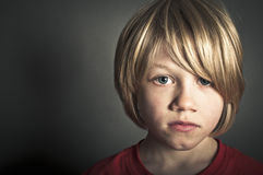 Child abuse. Concept of a young child who is subject to abuse Stock Photos