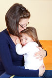 Child abuse. Scared little girl hugging her mother stock photos