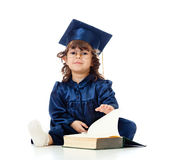 Child in academician clothes with book Royalty Free Stock Photography