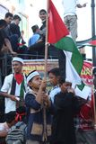 A child aceh with palestin flag. A child in aceh is hoisting palestin flag in action solidariti for palestin Royalty Free Stock Photography