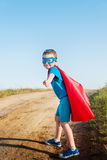 Child acting like a super hero Royalty Free Stock Photography