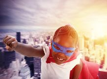 Child acts like a superhero to save the world royalty free stock photos