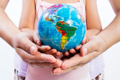Child and Adult Holding a World Globe in Hands Stock Photos