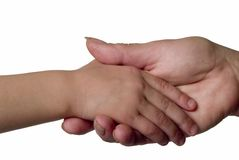 Child and adult shaking hands. Stock Photo