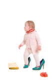 Child into adult shoes Royalty Free Stock Photography