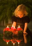 Child with Advent wreath Stock Photography