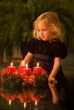 Child with Advent wreath Royalty Free Stock Image