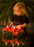 Child with Advent wreath royalty free stock photography