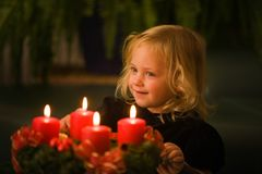 Child with Advent wreath Stock Photo