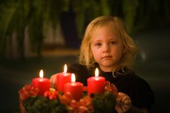 Child with Advent wreath stock images
